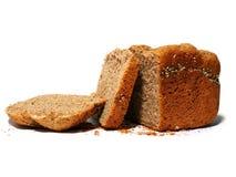 与种子的全麦面包,在切片的裁减 免版税库存图片