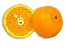 与种子的桔子切成了两半 免版税图库摄影