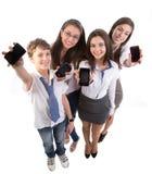 与移动电话的新成人 免版税库存照片