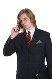与移动电话的生意人 免版税库存照片
