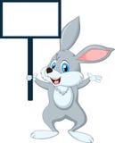 与空白的标志的逗人喜爱的动画片兔子 图库摄影