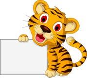 与空白的标志的逗人喜爱的小老虎 免版税库存图片