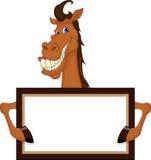 与空白的标志的逗人喜爱的马动画片 免版税库存图片