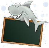 与空白的标志的逗人喜爱的鲨鱼字符 库存照片