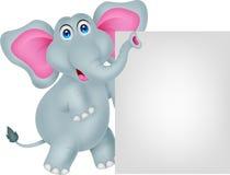 与空白的标志的滑稽的大象动画片 免版税库存照片