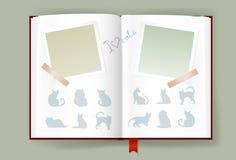 与空白的照片框架和猫剪影的被打开的册页 免版税库存照片