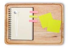 与空白的笔记本开放牙医工具和小pape的木头 库存照片