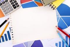与空白的笔记本页的财政背景 免版税库存照片