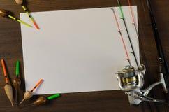 与空白的纸片的钓具 免版税库存照片