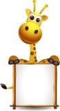 与空白符号的逗人喜爱的长颈鹿 免版税库存照片