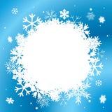 与空白雪花的蓝色冬天背景 库存图片