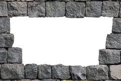 与空的孔的石熔岩墙壁框架 免版税库存图片