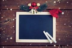 与空的粉笔板的圣诞节背景 免版税图库摄影