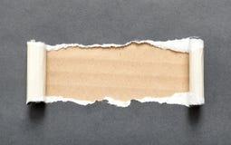 与空间的被撕毁的黑色纸张您的消息的 免版税库存图片