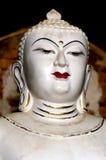 与突出的金黄三只眼的古色古香的白色菩萨画象 免版税库存图片