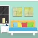 与窗口、表和壁画的卧室内部 库存图片