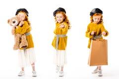 与站立与玩具熊和购物袋的时髦的孩子的拼贴画 库存图片