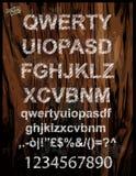 与笔剪影作用的杂文字母表 图库摄影