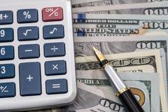 与笔和计算器的美元 免版税库存图片
