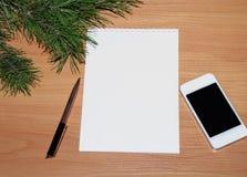 与笔的笔记薄笔记的 免版税库存图片