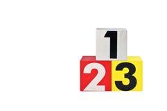 与第123的三个五颜六色的多维数据集 免版税库存照片