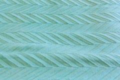 与箭头样式背景纹理样式的软的绿松石织品 库存照片