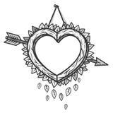 与箭头的心脏木制框架 库存图片