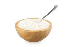 与米和钢匙子的木碗 图库摄影