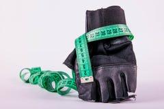 与米的健身手套 图库摄影
