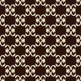 与米黄样式的无缝的样式在棕色背景 库存图片