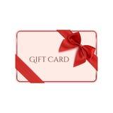 与红色丝带和弓的礼品券模板 免版税库存照片