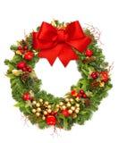 与红色丝带和装饰的圣诞节花圈 免版税图库摄影