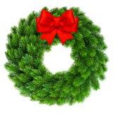 与红色丝带弓装饰的圣诞节花圈 图库摄影