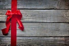 与红色丝带的圣诞节抽象背景 免版税库存图片