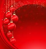 与红色中看不中用的物品的圣诞快乐卡片 图库摄影
