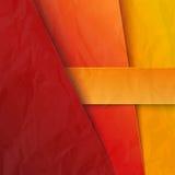 与红色和橙色纸层数的抽象背景 免版税图库摄影