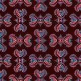 与红色和蓝色金属装饰装饰品的豪华无缝的样式在深红背景 库存图片
