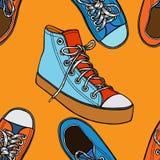 与红色和蓝色鞋子的无缝的样式 库存例证