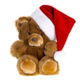 与红色圣诞老人帽子的逗人喜爱的葡萄酒玩具熊 免版税库存图片