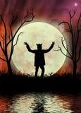 与红色天空和moonscape的狼人 免版税库存图片