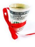 与红色弓关闭的卷美元 库存照片