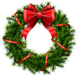 与红色弓和丝带的圣诞节花圈 免版税库存图片