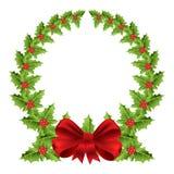 与红色弓的圣诞节花圈 免版税库存图片