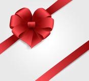 与红色弓的节假日背景 免版税库存照片