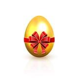 与红色弓的金黄鸡蛋 免版税库存图片