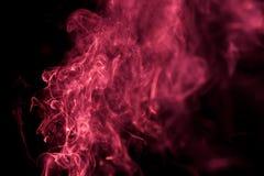 与红色彩色烟幕的抽象背景 库存图片