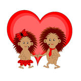 与红色心脏的两三只滑稽的动画片猬 免版税库存图片