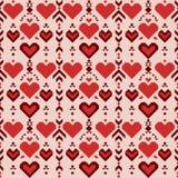 与红色心脏的无缝的几何样式 库存图片