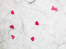 与红色心脏的桑纸 库存照片
