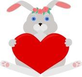 与红色心脏的灰色兔子 库存图片